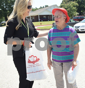Sharon Brown, vice president of The Smith County Adult Protective Services Board, gives an informational packet on elder abuse to Legends of Lindale independent living resident Cecil Szafran in Lindale May 6, 2016.  (Sarah A. Miller/Tyler Morning Telegraph)