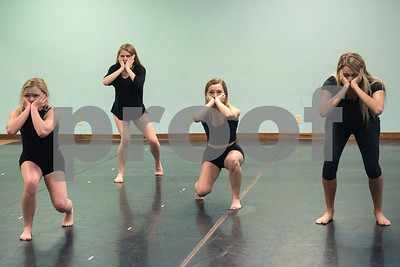 """Dancers practice the choreography of a dance titled """"Trafficking"""" by Artistic Dance Concepts instructor Bonnie Hotman-Pehl May 18, 2016. """"Trafficking"""" takes on the serious issue of human trafficking. A video of the dance posted to YouTube has been viewed several thousand times.  (Sarah A. Miller/Tyler Morning Telegraph)"""