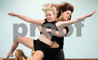 """Kenzi Payne carries Lindey Thomas away as part of the  choreography of a dance titled """"Trafficking"""" by Artistic Dance Concepts instructor Bonnie Hotman-Pehl. """"Trafficking"""" takes on the serious issue of human trafficking. A video of the dance posted to YouTube has been viewed several thousand times.  (Sarah A. Miller/Tyler Morning Telegraph)"""