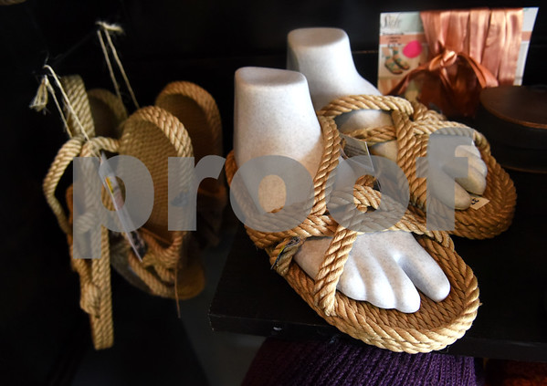 Sandals are pictured at Come Together Trading in Tyler Thursday May 19, 2016. The fair trade shop is closing its Tyler location to take the store on the road for outdoor events, festivals, and shows. The store will still exist online as cometogethertrading.com and a mini-market is featured at Fly & Love Yoga Lounge in Flint.  (Sarah A. Miller/Tyler Morning Telegraph)