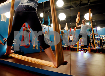 Violet Orchard, 14, stands on an aerial swing during an aerial yoga class at Fly and Love Yoga Lounge, 17968 FM 2493 in Flint May 16, 2016. Fly and Love includes a large lounge area complete with free Wi-Fi, coffee, tea and juice for purchase, coloring books, local art and items for sale from the fair trade Come Together Trading Company.   (Sarah A. Miller/Tyler Morning Telegraph)