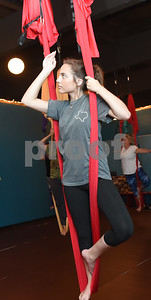 Emily Hill of Bullard stands on a swing during an aerial yoga class at Fly and Love Yoga Lounge, 17968 FM 2493 in Flint May 16, 2016. Fly and Love includes a large lounge area complete with free Wi-Fi, coffee, tea and juice for purchase, coloring books, local art and items for sale from the fair trade Come Together Trading Company.   (Sarah A. Miller/Tyler Morning Telegraph)