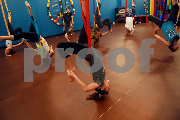 Emily Hill of Bullard spins upside down during an aerial yoga class at Fly and Love Yoga Lounge, 17968 FM 2493 in Flint May 16, 2016. Fly and Love includes a large lounge area complete with free Wi-Fi, coffee, tea and juice for purchase, coloring books, local art and items for sale from the fair trade Come Together Trading Company.   (Sarah A. Miller/Tyler Morning Telegraph)