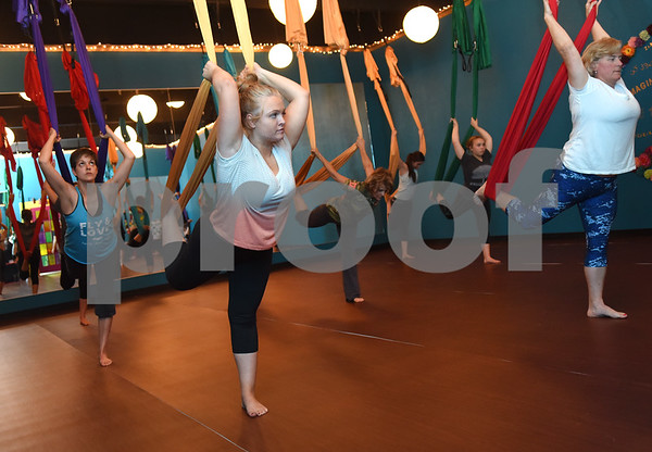 Ashton Blalock of Tyler, front left, takes her first aerial yoga class at Fly and Love Yoga Lounge, 17968 FM 2493 in Flint May 16, 2016. Fly and Love includes a large lounge area complete with free Wi-Fi, coffee, tea and juice for purchase, coloring books, local art and items for sale from the fair trade Come Together Trading Company.   (Sarah A. Miller/Tyler Morning Telegraph)