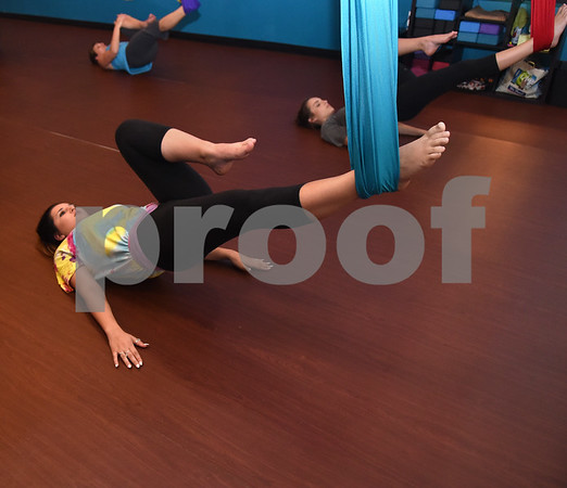 Caper Bingham of Bullard takes an aerial yoga class at Fly and Love Yoga Lounge, 17968 FM 2493 in Flint May 16, 2016. Fly and Love includes a large lounge area complete with free Wi-Fi, coffee, tea and juice for purchase, coloring books, local art and items for sale from the fair trade Come Together Trading Company.   (Sarah A. Miller/Tyler Morning Telegraph)