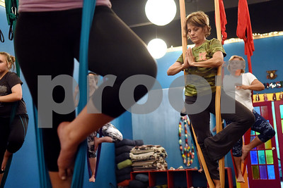 Pam Burton of Lindale stands on an aerial swing during an aerial yoga class at Fly and Love Yoga Lounge, 17968 FM 2493 in Flint May 16, 2016. Fly and Love includes a large lounge area complete with free Wi-Fi, coffee, tea and juice for purchase, coloring books, local art and items for sale from the fair trade Come Together Trading Company.   (Sarah A. Miller/Tyler Morning Telegraph)