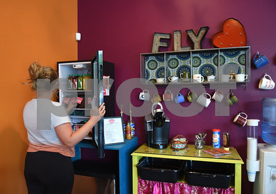 Ashton Blalock of Tyler looks at juice and snacks inside the lounge area at Fly and Love Yoga Lounge, 17968 FM 2493 in Flint May 16, 2016. Fly and Love includes a large lounge area complete with free Wi-Fi, coffee, tea and juice for purchase, coloring books, local art and items for sale from the fair trade Come Together Trading Company.   (Sarah A. Miller/Tyler Morning Telegraph)