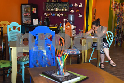 Rebecca Petty of Tyler uses the lounge area inside Fly and Love Yoga Lounge, 17968 FM 2493 in Flint May 16, 2016. Fly and Love includes a large lounge area complete with free Wi-Fi, coffee, tea and juice for purchase, coloring books, local art and items for sale from the fair trade Come Together Trading Company.   (Sarah A. Miller/Tyler Morning Telegraph)
