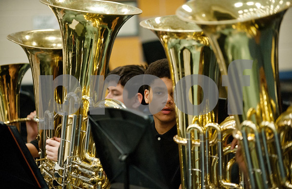 Hubbard Middle School tuba player Miles Minnick, 17, waits for his band director to start conducting the band's first song during the Tyler ISD ArtsFest held Saturday at Harvey Hall in Tyler. The event featured artwork from Tyler ISD students as well as arts and crafts activities and  live choir, band, orchestra and dance performances.  (photo by Sarah A. Miller/Tyler Morning Telegraph)