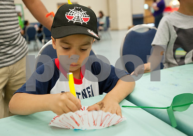 Emiliano Vazquez, 4, of Tyler, makes a flower during the Tyler ISD ArtsFest held Saturday at Harvey Hall in Tyler. The event was hosted by the Tyler ISD Visual and Performing Arts Department and  featured artwork from students as well as arts and crafts activities and  live choir, band, orchestra and dance performances.  (photo by Sarah A. Miller/Tyler Morning Telegraph)