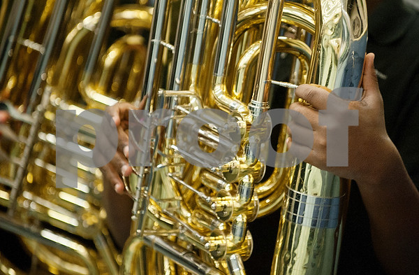 Hubbard Middle School student Natavien Martin, 13, plays the tuba during the Tyler ISD ArtsFest held Saturday at Harvey Hall in Tyler. The event featured artwork from Tyler ISD students as well as arts and crafts activities and  live choir, band, orchestra and dance performances.  (photo by Sarah A. Miller/Tyler Morning Telegraph)