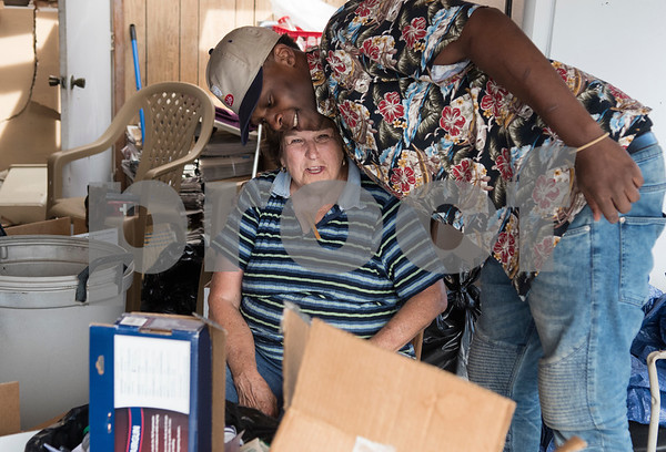 Volunteer Ramon Readus of McKinney hugs tornado victim Patty Hunter at her home on Van Zandt County Road 2301 north of Canton, Texas Tuesday May 2, 2017. The Readus family delivered hot meals to tornado victims at their homes Tuesday.  (Sarah A. Miller/Tyler Morning Telegraph)