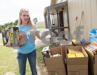 Misti Townsend hands out garbage bags, shovels and other supplies to volunteers based at the Van Zandt County Fairgrounds in Canton, Texas Tuesday May 2, 2017.   (Sarah A. Miller/Tyler Morning Telegraph)