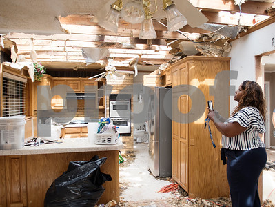 Volunteer Marisa Readus of McKinney takes a photo of the destruction of a home on Van Zandt County Road 2301 north of Canton, Texas Tuesday May 2, 2017. Readus and her twin sister Alisha Readus delivered hot meals to tornado victims at their homes Tuesday.  (Sarah A. Miller/Tyler Morning Telegraph)