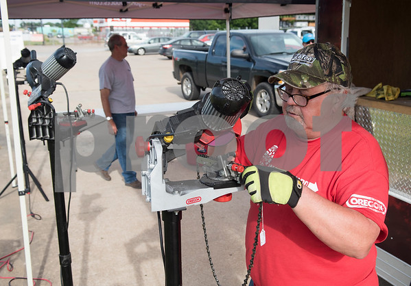 Tommy Stahl volunteers his time sharpening chainsaws for free in the parking lot of Ace Hardware in Canton, Texas Tuesday May 2, 2017. Stahl is one of many volunteers in Canton helping out victims of Saturday's tornadoes that hit the area.  (Sarah A. Miller/Tyler Morning Telegraph)
