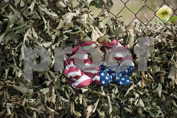 An American flag is pinned against the fence of the Old Bethel Cemetery north of Canton, Texas Tuesday May 2, 2017.   (Sarah A. Miller/Tyler Morning Telegraph)