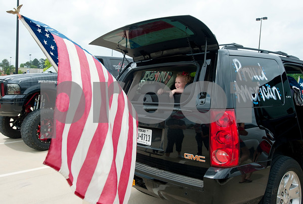 Hudsyn McLean, 3, of Whitehouse, waits for the East Texas Flag Coalition ride to being in Tyler, Texas Saturday May 23, 2015. Over 30 vehicles participated in the East Texas Flag Coalition ride. The East Texas Flag Coalition is a patriotic group that aims to visibly show their American pride by places flags on trucks, cars and motorcycles during their community rides.  (photo by Sarah A. Miller/Tyler Morning Telegraph)