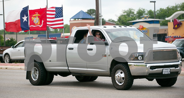 A truck flying the Texas flag, Marine Corps flag and United States flag travels north on Broadway Ave. from the Village at Cumberland Park to T.B. Butler Fountain Square in downtown Tyler, Texas Saturday May 23, 2015. The truck was one of over 30 vehicles participating in the East Texas Flag Coalition ride. The East Texas Flag Coalition is a patriotic group that aims to visibly show their American pride by places flags on trucks, cars and motorcycles during their community rides.  (photo by Sarah A. Miller/Tyler Morning Telegraph)