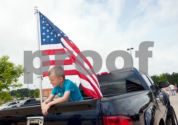 Kurt LaCoste, 6, of Flint, waits for the East Texas Flag Coalition ride to being in Tyler, Texas Saturday May 23, 2015. Over 30 vehicles participated in the East Texas Flag Coalition ride. The East Texas Flag Coalition is a patriotic group that aims to visibly show their American pride by places flags on trucks, cars and motorcycles during their community rides.  (photo by Sarah A. Miller/Tyler Morning Telegraph)