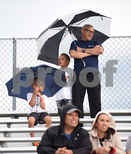 Football fans use umbrellas to stay dry at the John Tyler High School spring football game Thursday May 26, 2016 in Tyler.  (Sarah A. Miller/Tyler Morning Telegraph)