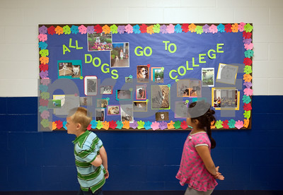 "photo by Sarah A. Miller/Tyler Morning Telegraph  Wise Elementary Magnet School students walk past a bulletin board Wednesday inspired by ""My Story"" a children's book written by Tyler Junior College President Dr. Mike Metke from the perspective of his dog Foxy."