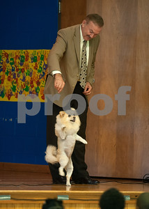 """photo by Sarah A. Miller/Tyler Morning Telegraph  Tyler Junior College President Dr. Mike Metke has his dog Foxy perform tricks during an all-school assembly Wednesday morning at Wise Elementary Magnet School in Chapel Hill where he and his wife Donna read the children's book """"My Story"""" that Dr. Metke wrote from the dog's perspective."""