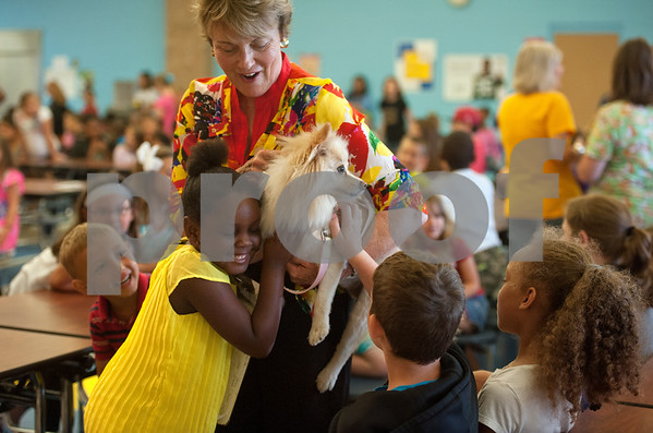 "photo by Sarah A. Miller/Tyler Morning Telegraph  Wise Elementary Magnet School kindergartner Katelyn Swindell, 6, hugs Foxy the Pomeranian as Donna Metke, wife of Tyler Junior College President Dr. Mike Metke, brings her through the cafeteria for students to pet. Donna Metke read the children's book ""My Story"" that her husband wrote from the perspective of their dog Foxy during an all-school assembly Wednesday morning at Wise Elementary Magnet School in Chapel Hill."