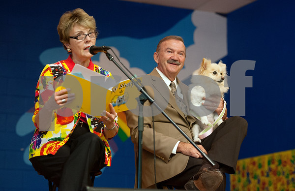"photo by Sarah A. Miller/Tyler Morning Telegraph  Donna Metke, wife of Tyler Junior College President Dr. Mike Metke, pictured at right, reads the children's book ""My Story"" that her husband wrote from the perspective of their dog Foxy during an all-school assembly Wednesday morning at Wise Elementary Magnet School in Chapel Hill."