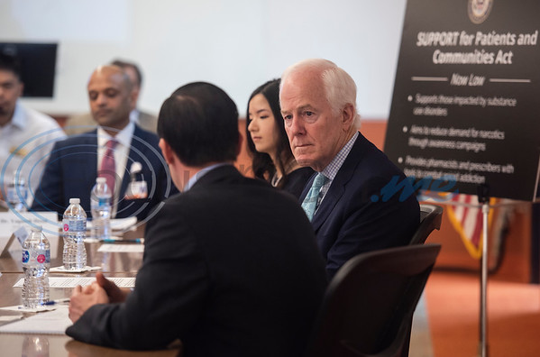 U.S. Senator John Cornyn (R-TX), listens as Smith County District Attorney Jacob Putman speaks during a roundtable discussion on Wednesday May 29, 2019 at W.T. Brookshire Hall at The University of Texas at Tyler on opioid addiction and how legislation which was recently signed into law, the SUPPORT for Patients and Communities Act. Representatives from The University of Texas at Tyler's Pharmacy School, the East Texas Council on Alcoholism and Drug Abuse, local health care providers, law enforcement officers, and community leaders discussed their efforts to help those with substance abuse problems get into treatment and recovery programs, and how to work to prevent illegal drug use. Following the roundtable, Sen. Cornyn toured UT-Tyler's Fisch College of Pharmacy.  (Sarah A. Miller/Tyler Morning Telegraph)