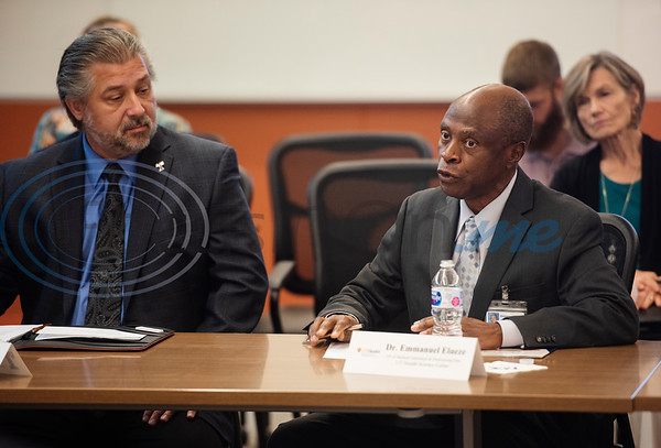 Dr. Lane Brunner, Dean of the Fisch College of Pharmacy, at left, listens as Emmanuel Elueze, VP of Medical Education and Professional Development at UT Health Science Center speaks during a roundtable discussion at the school about opioid addiction on Wednesday May 29, 2019 at W.T. Brookshire Hall at The University of Texas at Tyler. The roundtable discussed how legislation which was recently signed into law, the SUPPORT for Patients and Communities Act and was attended by representatives from UT-Tyler, the East Texas Council on Alcoholism and Drug Abuse, local health care providers, law enforcement officers, and community leaders.  (Sarah A. Miller/Tyler Morning Telegraph)