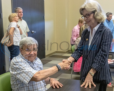 Morris Bowen (l)  is greeted by City Councilman for District 1 Linda Sellers, at the Roosth Properties community meeting to discuss a new development plan, Thursday, May 30, 2019. The community meeting was held at the Faulkner Park police substation, in Tyler.. (Rick Flack Photo)