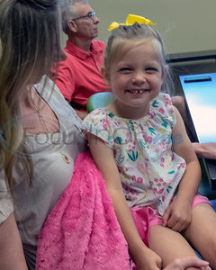 3 year old  Stella Alberti smiles for the camera at the Roosth Properties community meeting to discuss a new development plan, Thursday, May 30, 2019. The community meeting was held at the Faulkner Park police substation, in Tyler.. (Rick Flack Photo)