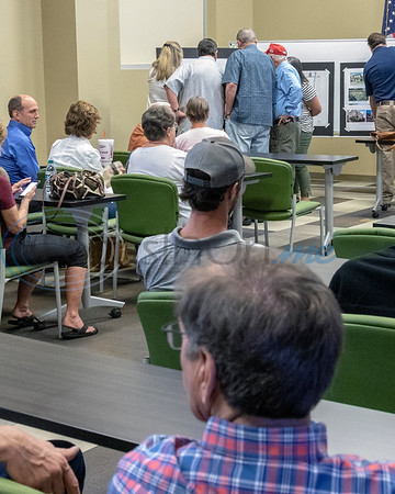 Meeting attendees gather around charts and graphs prior to the start of the Roosth Properties community meeting to discuss a new development plan, Thursday, May 30, 2019. The community meeting was held at the Faulkner Park police substation, in Tyler.. (Rick Flack Photo)