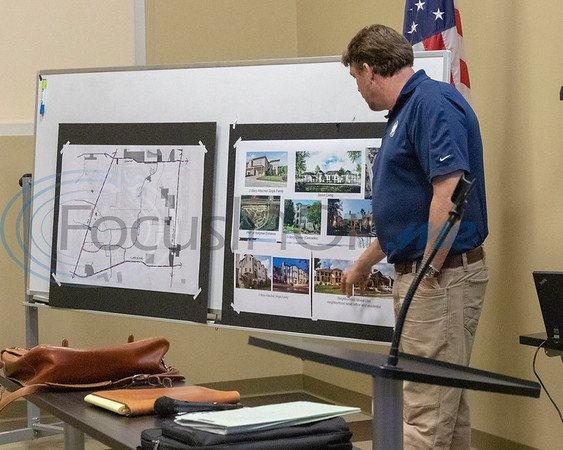 Mark Priestner, Planning Concepts, explains some photographs at the Roosth Properties community meeting to discuss a new development plan, Thursday, May 30, 2019. The community meeting was held at the Faulkner Park police substation, in Tyler.. (Rick Flack Photo)