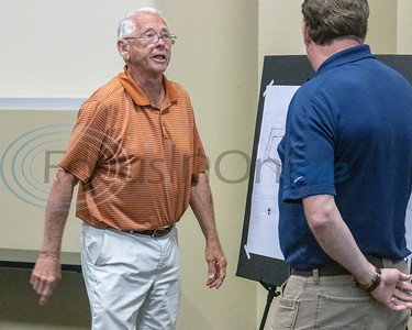 A member of the audience seeks clarification from Mark Priestner (r) at the Roosth Properties community meeting to discuss a new development plan, Thursday, May 30, 2019. The community meeting was held at the Faulkner Park police substation, in Tyler.. (Rick Flack Photo)