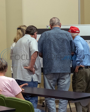 Several members attending the meeting check out the various maps and charts at the Roosth Properties community meeting to discuss a new development plan, Thursday, May 30, 2019. The community meeting was held at the Faulkner Park police substation, in Tyler.. (Rick Flack Photo)
