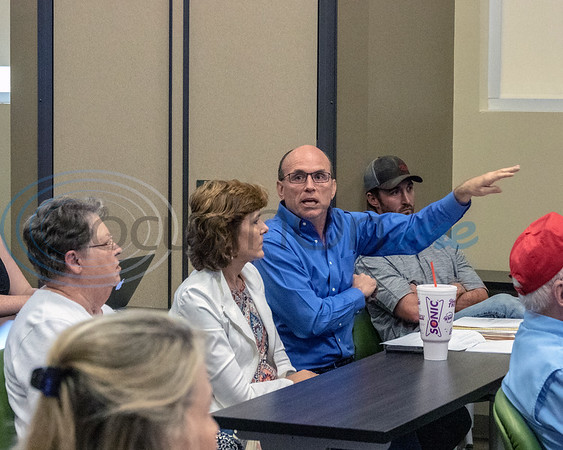 Mark Loughmiller, Bishops Gate HOA, asks a question at the Roosth Properties community meeting to discuss a new development plan, Thursday, May 30, 2019. The community meeting was held at the Faulkner Park police substation, in Tyler.. (Rick Flack Photo)
