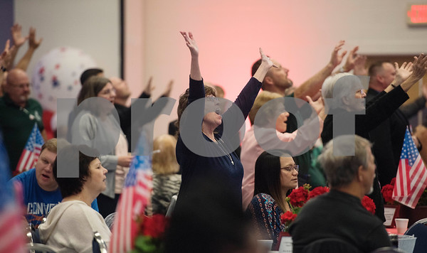 People sing during the 26th Annual Mayor's Prayer Breakfast held Thursday May 4, 2017 at Harvey Convention Center in Tyler. The event coincides with the National Day of Prayer and offers an opportunity for residents, area leaders and city officials to come together and pray for specific topics like unity, schools, and local and national government.  (Sarah A. Miller/Tyler Morning Telegraph)