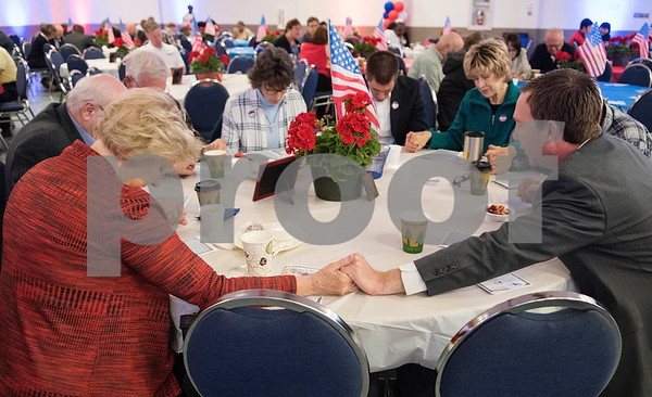 People pray at their tables during the 26th Annual Mayor's Prayer Breakfast held Thursday May 4, 2017 at Harvey Convention Center in Tyler. The event coincides with the National Day of Prayer and offers an opportunity for residents, area leaders and city officials to come together and pray for specific topics like unity, schools, and local and national government.  (Sarah A. Miller/Tyler Morning Telegraph)