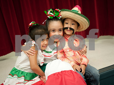 Evelyn Perez, 3, Jayda Cano, 6 and Moises Cano, 4, pose for a photo from their families after the annual Cinco de Mayo program at Bonner Elementary Tuesday May 5. Students from the headstart program, pre-kindergarten, kindergarten, and first and second grades performed traditional Mexican dances and sang songs to celebrate the holiday.  (photo by Sarah A. Miller/Tyler Morning Telegraph)