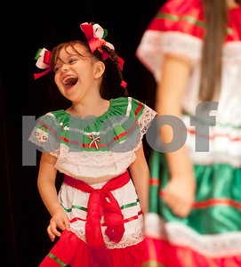 Yadira Lopez, 5, laughs as she dances with her classmates during the annual Cinco de Mayo program at Bonner Elementary Tuesday May 5. Students from the headstart program, pre-kindergarten, kindergarten, and first and second grades performed traditional Mexican dances and sang songs to celebrate the holiday.  (photo by Sarah A. Miller/Tyler Morning Telegraph)