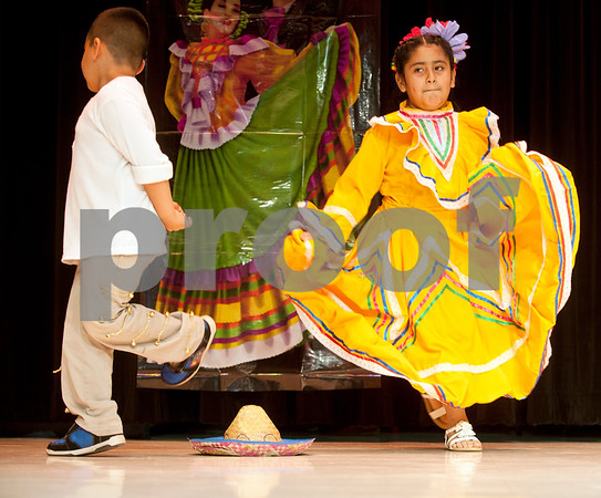 Students Johnathan Sanchez and Gabriela Blanco dance the Mexican Hat Dance during the annual Cinco de Mayo program at Bonner Elementary Tuesday May 5. Students from the headstart program, pre-kindergarten, kindergarten, and first and second grades performed traditional Mexican dances and sang songs to celebrate the holiday.  (photo by Sarah A. Miller/Tyler Morning Telegraph)