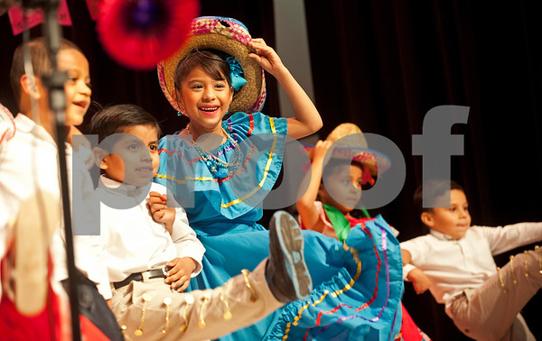 Jacqueline Ortiz, center in blue, dances with her classmates during the annual Cinco de Mayo program at Bonner Elementary Tuesday May 5. Students from the headstart program, pre-kindergarten, kindergarten, and first and second grades performed traditional Mexican dances and sang songs to celebrate the holiday.  (photo by Sarah A. Miller/Tyler Morning Telegraph)