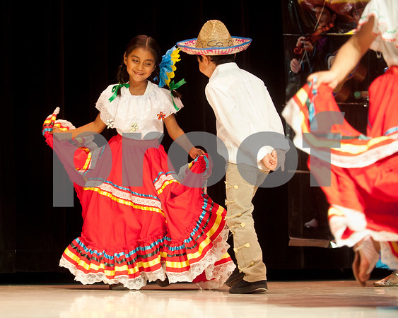 Valeria Rodriguez and classmates dance the Mexican Hat Dance during the annual Cinco de Mayo program at Bonner Elementary Tuesday May 5. Students from the headstart program, pre-kindergarten, kindergarten, and first and second grades performed traditional Mexican dances and sang songs to celebrate the holiday.  (photo by Sarah A. Miller/Tyler Morning Telegraph)