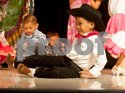 A young student break dances during the annual Cinco de Mayo program at Bonner Elementary Tuesday May 5. Students from the headstart program, pre-kindergarten, kindergarten, and first and second grades performed traditional Mexican dances and sang songs to celebrate the holiday.  (photo by Sarah A. Miller/Tyler Morning Telegraph)