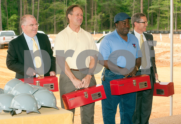 photo by Sarah A. Miller/Tyler Morning Telegraph  Tyler Police Chief Gary Swindle, City Councilman Mark Whatley, Councilman Ed Moore and City Manager Mark McDaniel hold tool boxes gifted to them at the groundbreaking ceremony for Saige Meadows, a new housing development located at 13488 Hwy 69 North in Tyler.