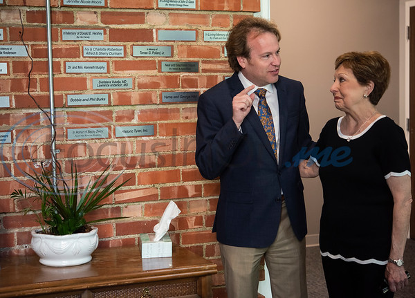 Patrick Willis shows Becky Berry the brick on the wall in her name at the United Way of Smith County's office at The Tyler Woman's Building on Tuesday May 7, 2019. Berry taught high school for more than 30 years, most of those at Robert E. Lee High School. The United Way of Smith County's 'Brick by Brick' campaign raises money for the renovation of the building and honors special individuals   (Sarah A. Miller/Tyler Morning Telegraph)