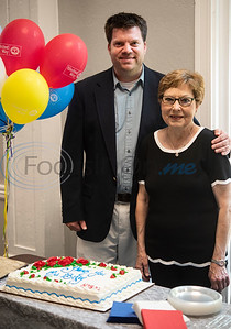 John Berry stands by his mother Becky Berry during a reception after the Brick by Brick reveal at The Tyler Woman's Building on Tuesday May 7, 2019. Mrs. Berry taught high school for more than 30 years, most of those at Robert E. Lee High School. The United Way of Smith County's 'Brick by Brick' campaign raises money for the renovation of the building and honors special individuals   (Sarah A. Miller/Tyler Morning Telegraph)