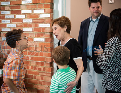 Reece Berry, 10, and Blake Berry, 7, visit with their grandmother Becky Berry during a reception after the Brick by Brick reveal at The Tyler Woman's Building on Tuesday May 7, 2019. Mrs. Berry taught high school for more than 30 years, most of those at Robert E. Lee High School. The United Way of Smith County's 'Brick by Brick' campaign raises money for the renovation of the building and honors special individuals   (Sarah A. Miller/Tyler Morning Telegraph)