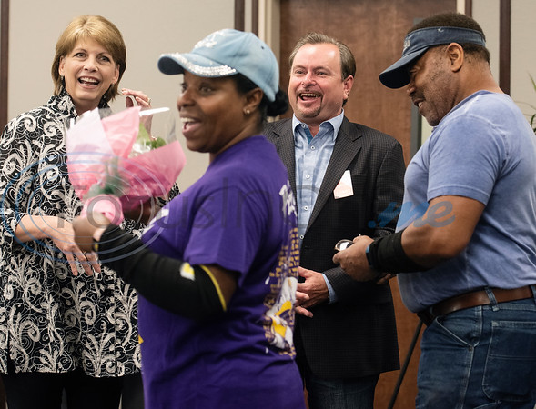 Rita and Herbert Washington of Tyler are surprised by Nan Moore of United Way of Smith County and Kirk Wallace, owner of Patterson Volkswagen with a new car that Herbert won by donating to the United Way of Smith County. The couple work together at the Ingersoll Rand/TRANE company in Tyler and were surprised at work with the announcement on Tuesday May 7, 2019.   (Sarah A. Miller/Tyler Morning Telegraph)